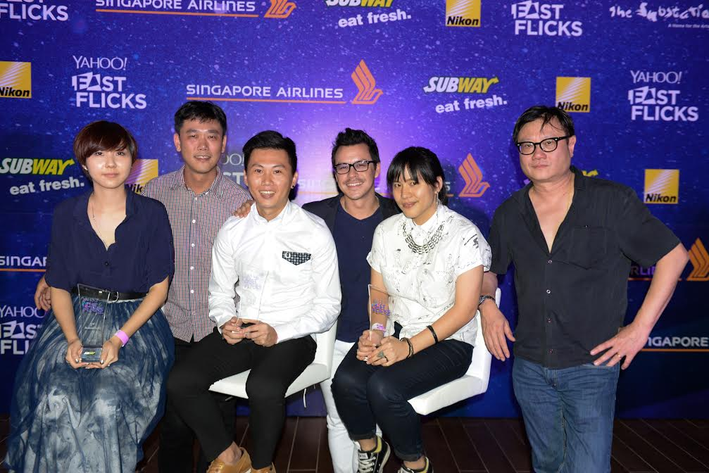 The three finalists of Yahoo Fast Flicks (sitting) with judges Zhang Wenjie, Mike Wiluan and Eric Khoo